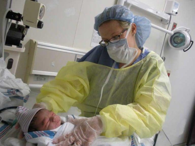 Resident attending an infant
