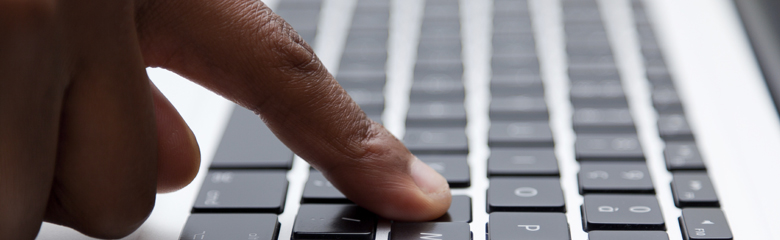 photo of index finger on a computer keyboard